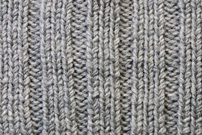 Knitting Patterns For Wool : Grey knitting background of handmade woolen pattern ...