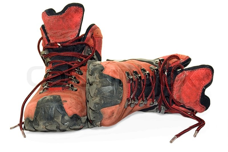 Dirty, used hiking boots over white | Stock Photo | Colourbox