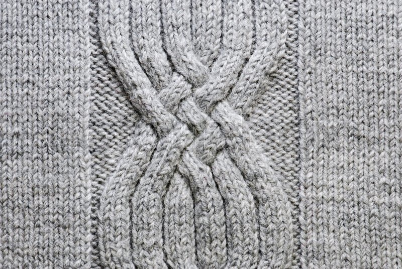 Grey knitting background of handmade woolen pattern Stock Photo Colourbox