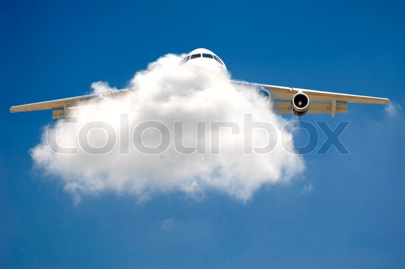 Stock image of 'Plane is flying through a cloud'