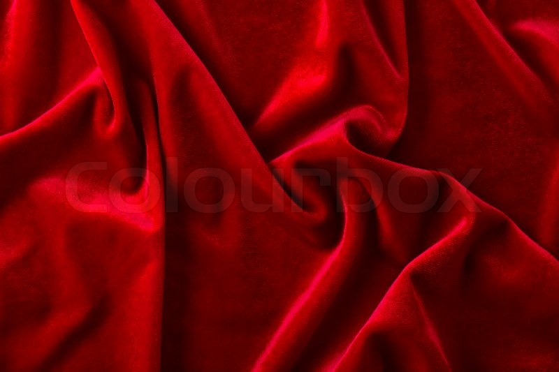 Background Of Red Velvet Fabric With Arbitrary Folds