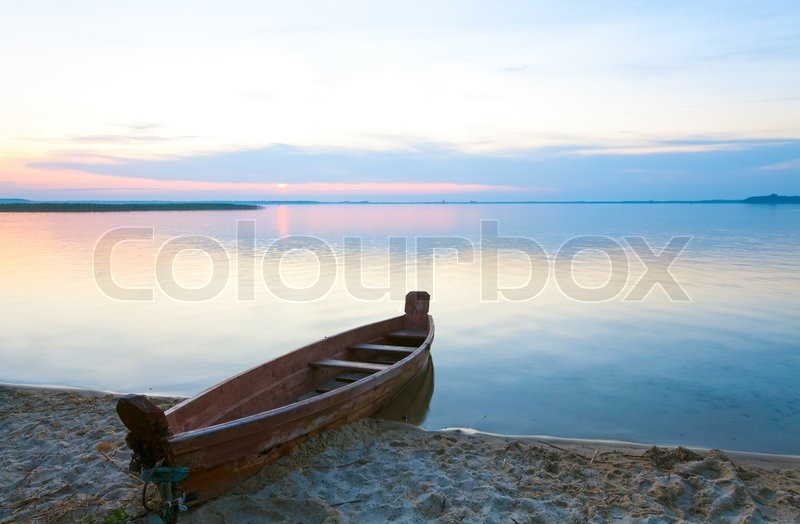 Sunset and old wooden fishing boat near the summer lake shore Svityaz, Ukraine | Stock Photo ...