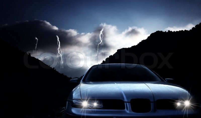 Car at night with thunderstorm, stock photo
