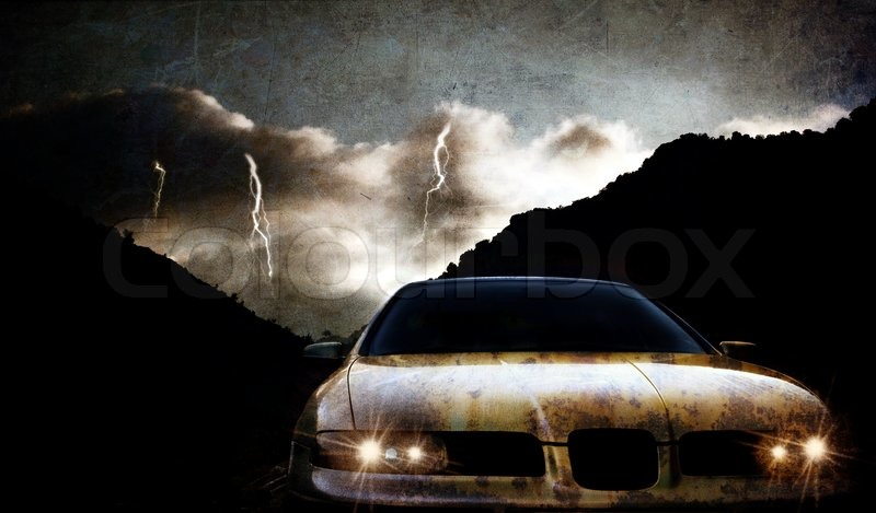 Grungy car at night with thunderstorm, stock photo