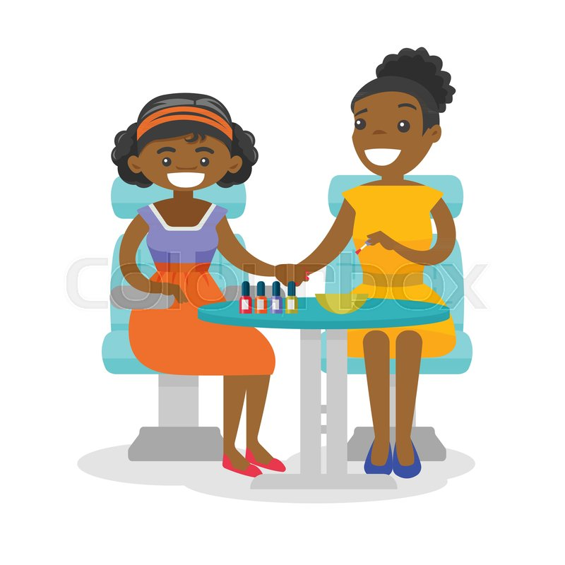 Young african-american woman getting manicure at the beauty salon ...