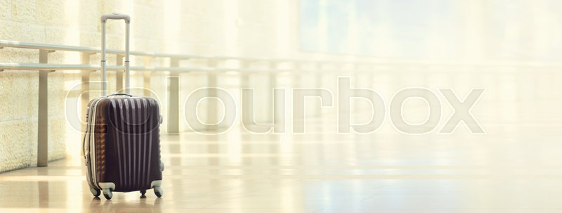 Packed travel suitcase, airport. Summer holiday and vacation concept. Traveler baggage, brown luggage in empty hall interior. Copy space. Banner, stock photo