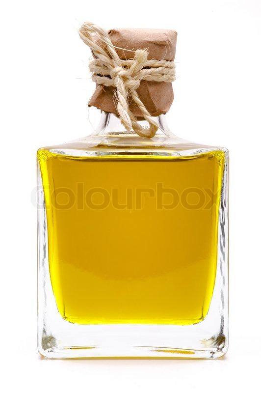 gelbe fl ssigkeit oliven l in einer flasche stockfoto. Black Bedroom Furniture Sets. Home Design Ideas