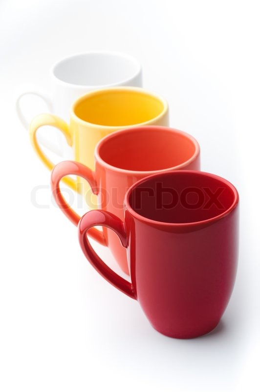 perspective row of bright colorful mugs red orange yellow and white on a white background stock photo - Colorful Mugs