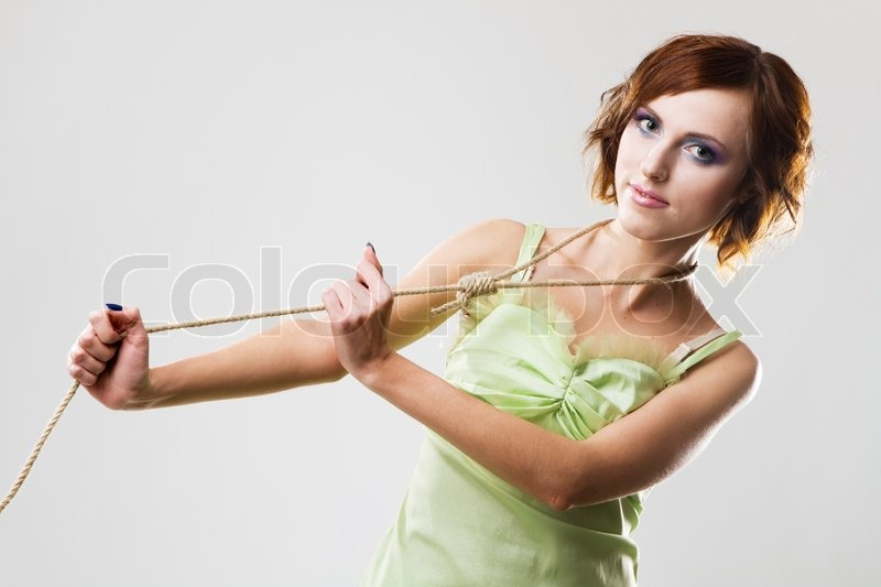 Stock image of 'Beautiful woman with hangman's noose, studio photo'