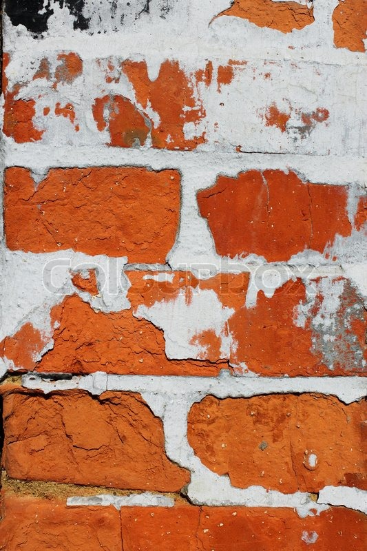 Stock image of 'Fragment of old brick wall with concrete covering shelled close up'