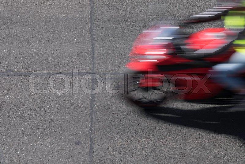 Blurred man and motorcycle on torn grunge asphalt city street in Australia, stock photo