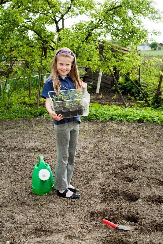 An Image Of A Nice Little Girl In The Garden Stock Photo Colourbox