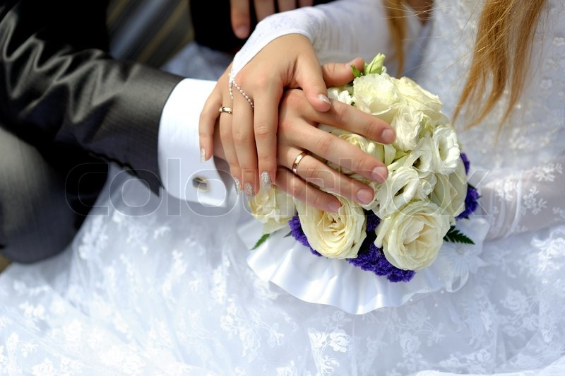 Hands of the groom and the bride with wedding rings Stock Photo