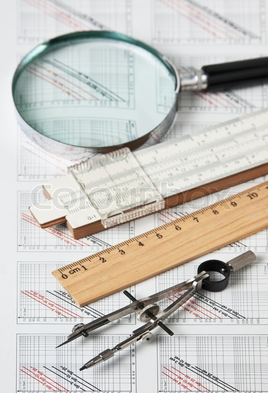 Engineering tools on a technical drawing, stock photo