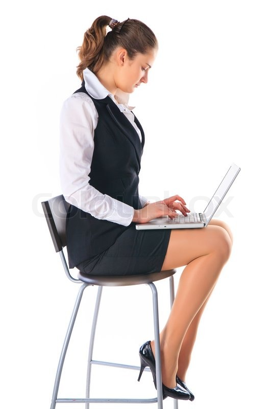 Business Woman Sitting On A High Chair And Works On The