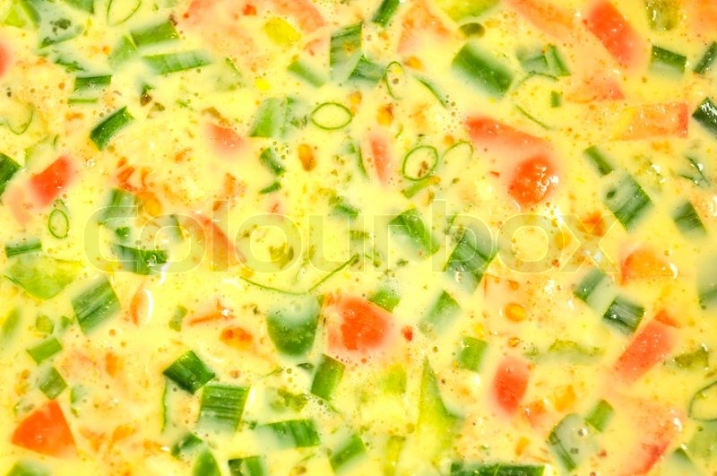 Raw Spring Onion and Tomato Omelet | Stock Photo | Colourbox