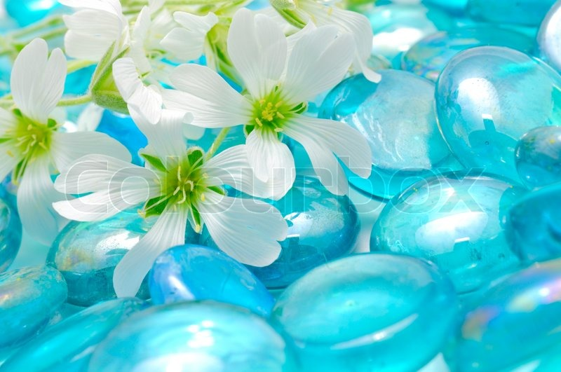 Delicate White Flowers On Blue Glass Stones
