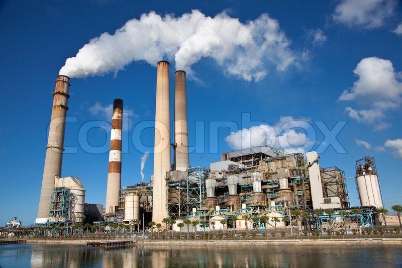 Power Plant With White Smoke Out Of Smokestack Stock
