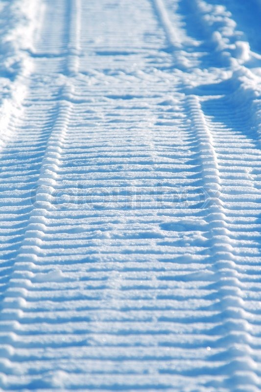 Snowmobile track on snow | Stock image | Colourbox