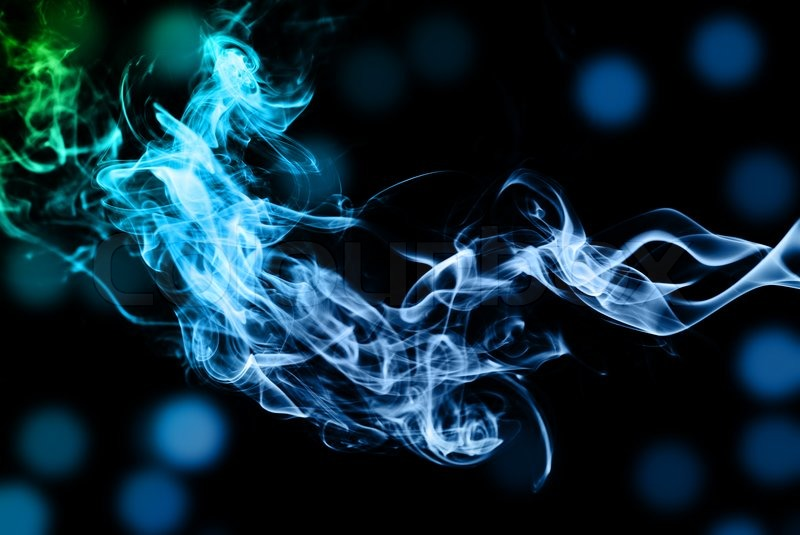 Abstract multi colored smoke puff isolated on white stock photo