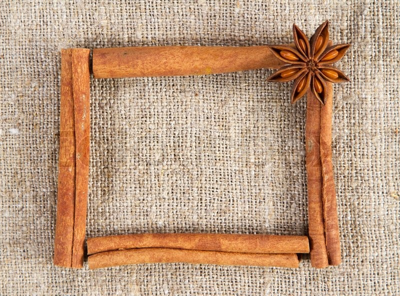 Cinnamon sticks frame on a sacking cloth | Stock Photo | Colourbox