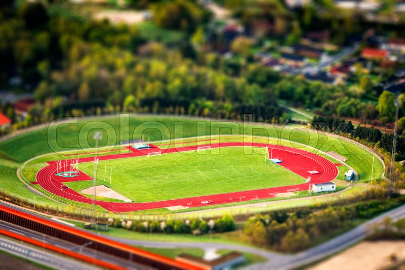 grass field from above. Athletic Stadium Seen From Above With Miniature Objects And A Grass Field  In The Center | Stock Photo Colourbox T