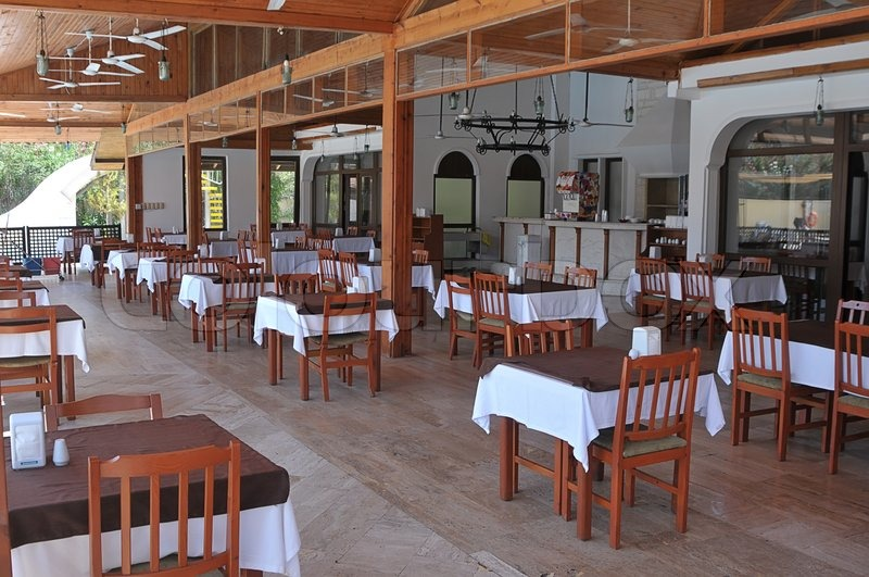 Image Of Rows Of Empty Tables And Chairs In An Open Air