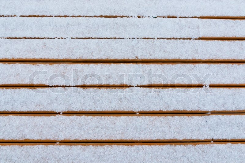 Fresh snow on wood deck boards background for your text