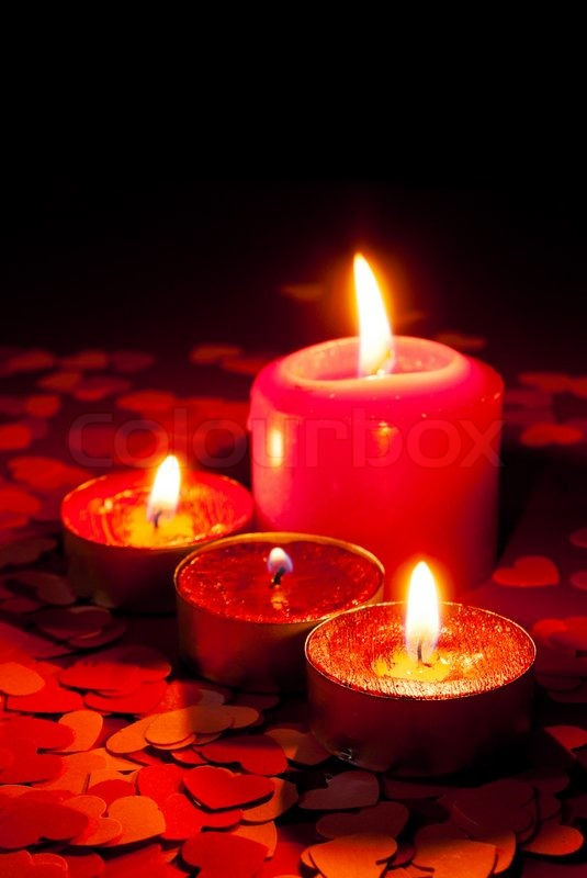 Four Burning Candles Over Red Background With Heart Shapes