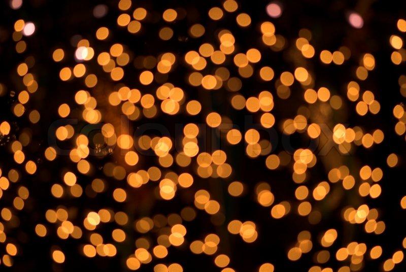 Defocused orange lights on black | Stock Photo | Colourbox