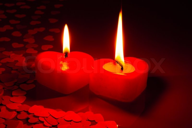 Two Burning Heart Shaped Candles Over Stock Photo