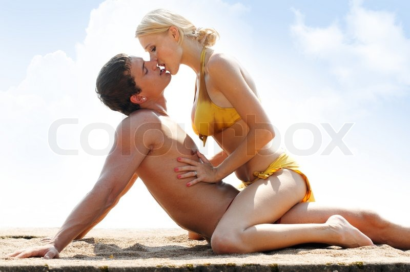Think, that young couple play on beach
