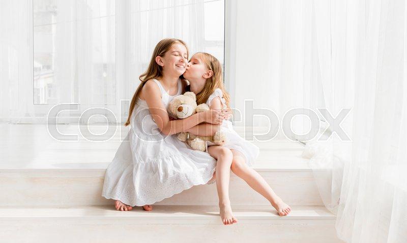 Girls hugging and kissing