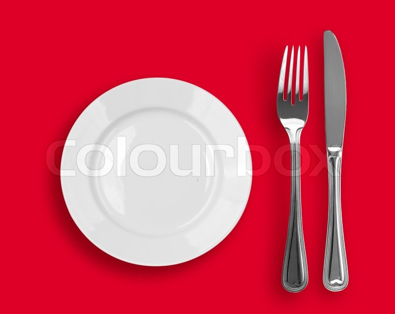 Knife White Plate And Fork On Red Stock Photo