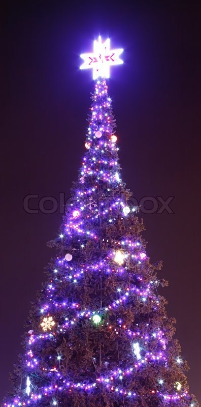 decorated christmas tree outside with lights covered with snow stock photo colourbox