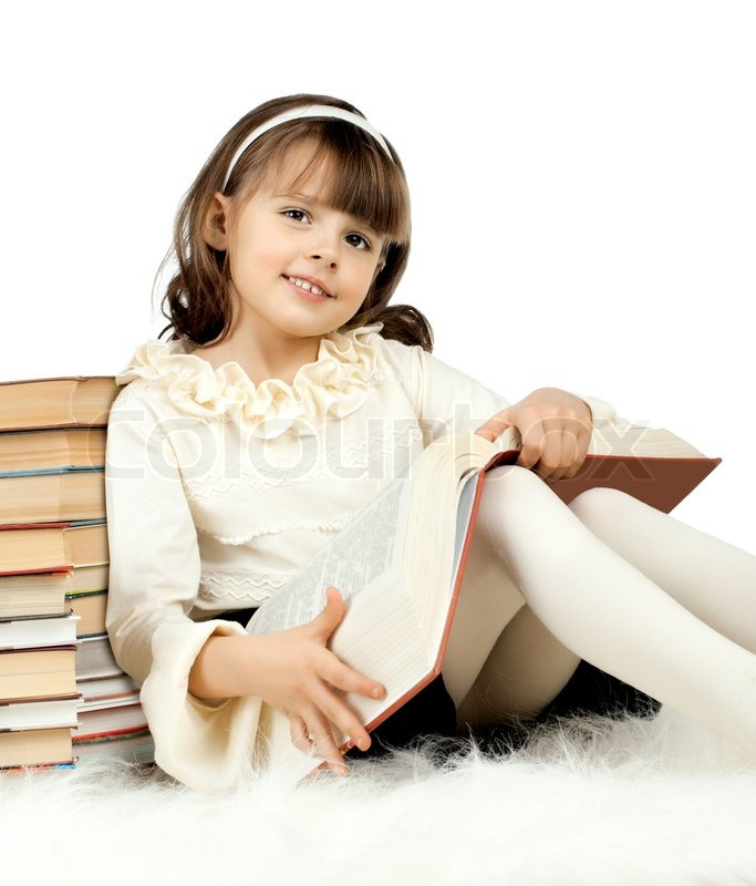 The cute little girl lie with textbook and happy smile on Cute teenage girls pics