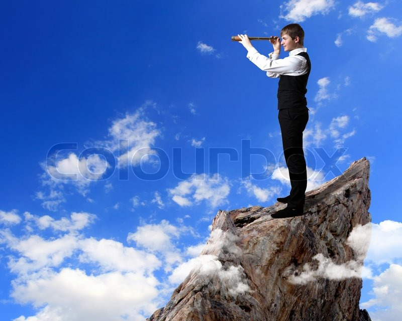 Young businessman standing and looking forward into the ...