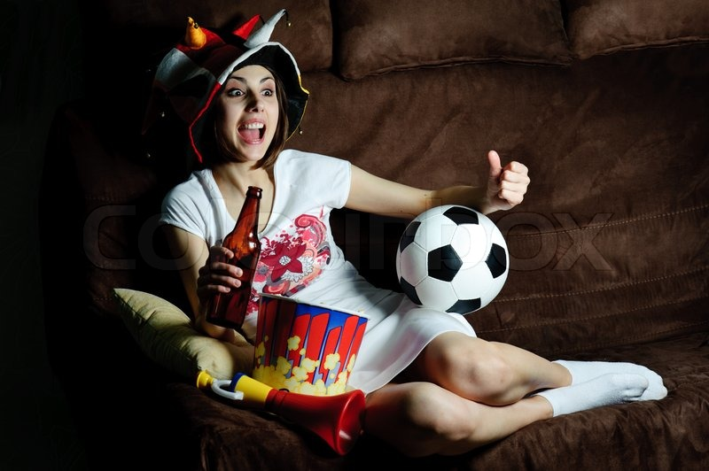 An Image Of A Girl On A Sofa Watching Football On Tv