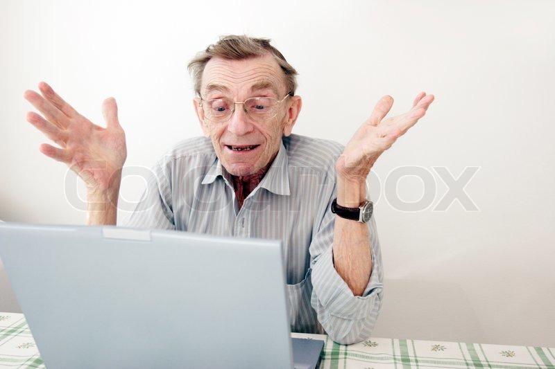 Senior Man Gesticulating Happily In Front Of His Computer