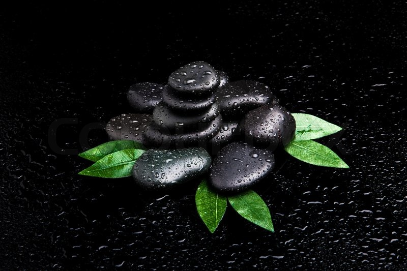blak spa stones with leaf and water drops stock photo colourbox