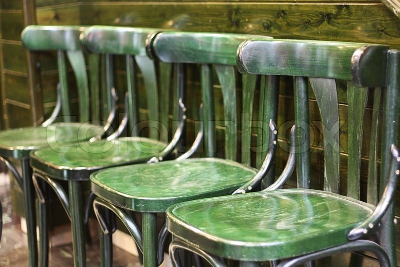 green wooden chairs in the cafe stock photo colourbox