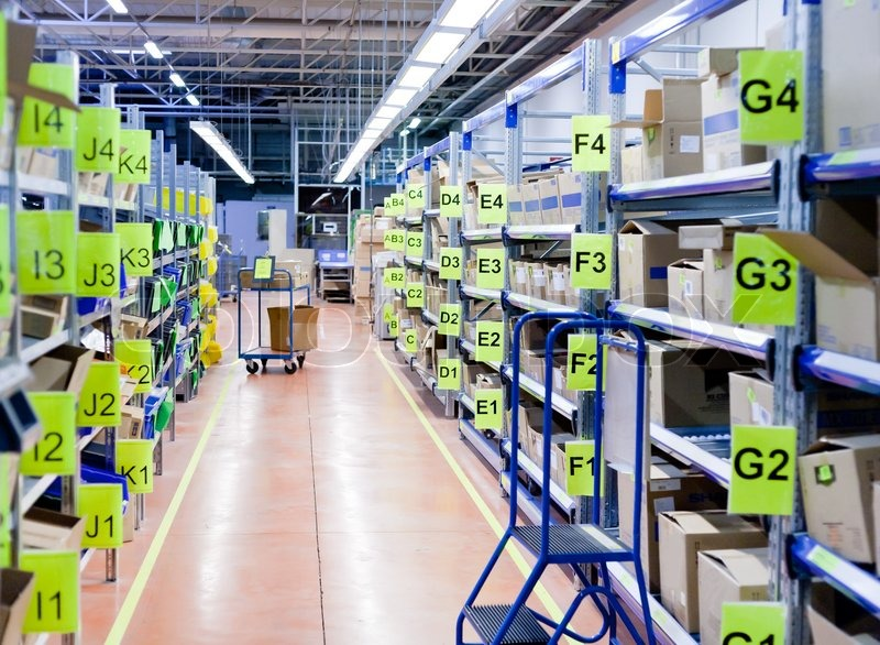 Stock image of 'Stands with carton boxes in storage warehouse'