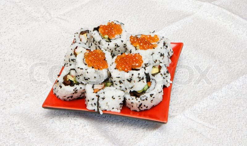 Homemade inside-out maki sushi with red caviar on red ...