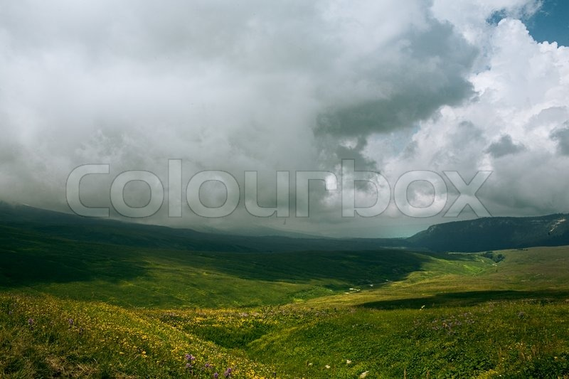 Landscape with low clouds bad weather, stock photo