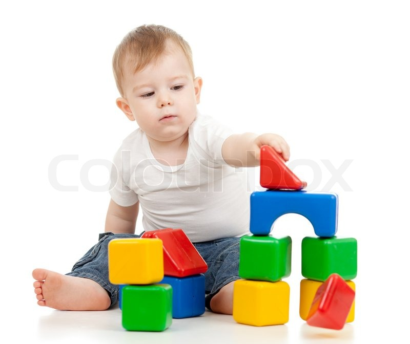 Little boy playing with building blocks | Stock Photo ...