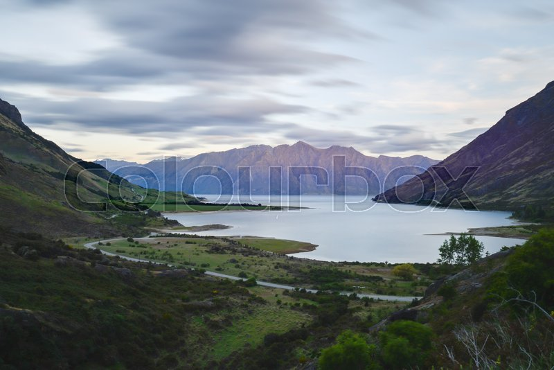 Lake Hawea in the middle of the valley in the evening at New Zealand Southland, stock photo