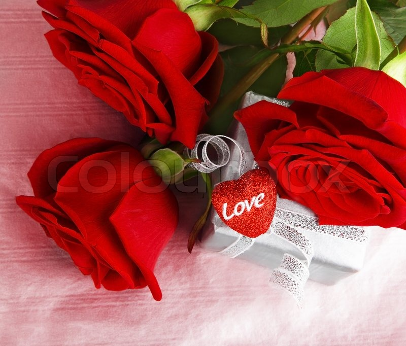 Romantic gift red roses isolated on pink background love romantic gift red roses isolated on pink background love concept stock photo negle Choice Image