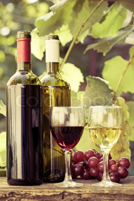 Red And White Wine Bottles Two Glasses And Bunch Of