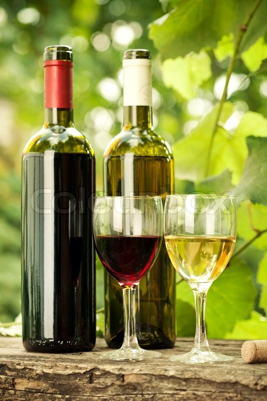 Red and white wine bottles and two glasses against for Red glass wine bottles suppliers