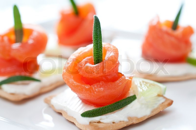 Canapes with smoked salmon and cream cheese close up for Smoked salmon cream cheese canape